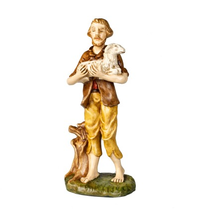 Pastore con pecora in braccio